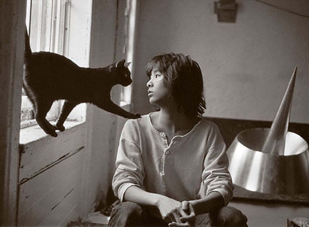 Maya Lin in studio with cat